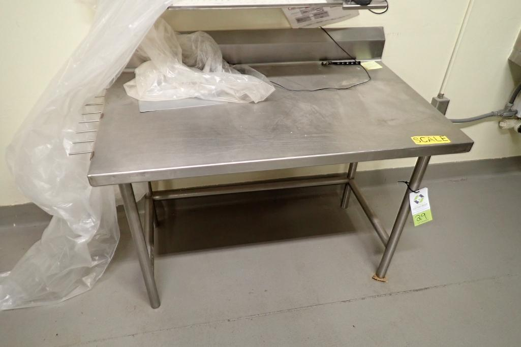 Lot 29 - SS table, 48 in. long x 30 in. wide x 36 in. tall.. **Rigging Fee: $50**
