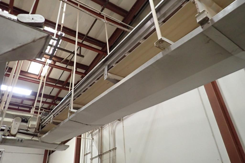 Lot 56 - SS belt conveyor, 36 ft. long x 24 in. wide, suspended from ceiling, with motor and drive. **Rigging