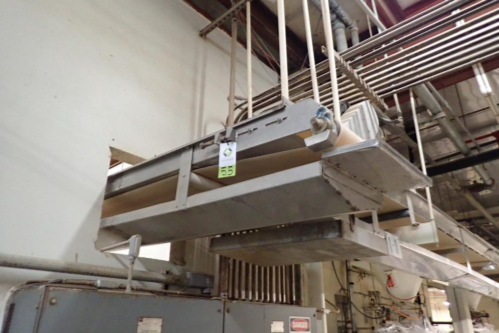 SS belt conveyor, 22 ft. long x 18 in. wide, suspended from ceiling, with motor and drive. **Rigging