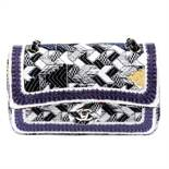 CHANEL - a Silicone-Covered Tweed Double Flap handbag.