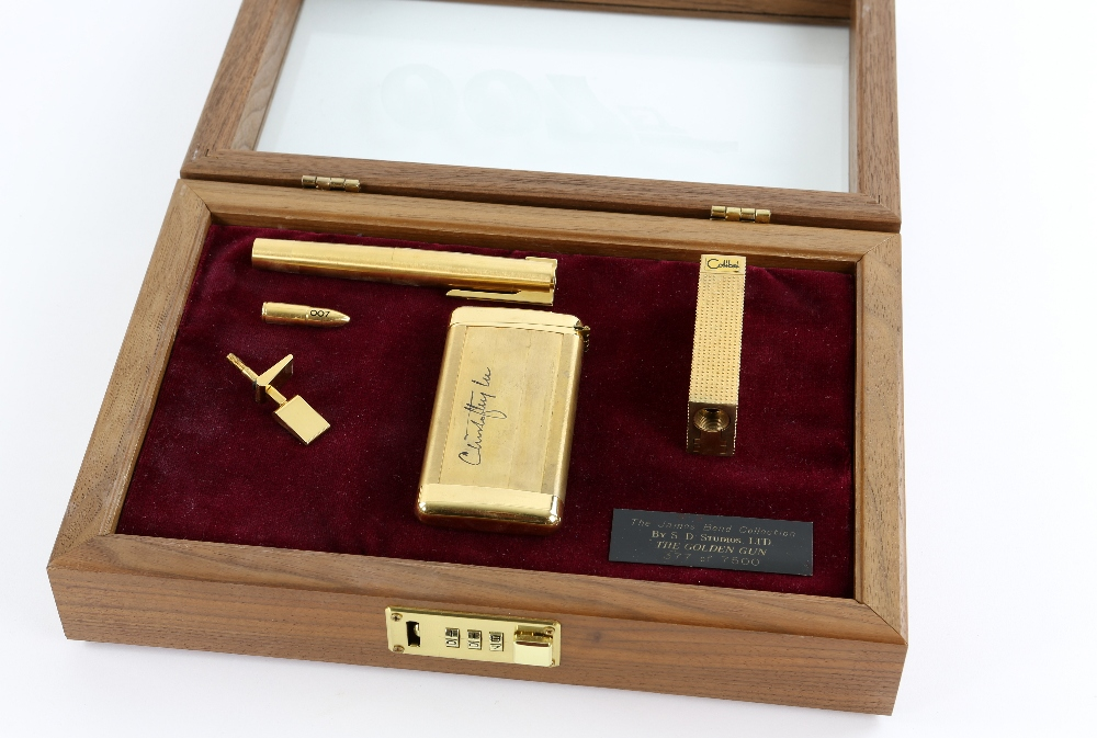 Lot 1209 - James Bond The Man With The Golden Gun - A replica golden gun, autographed by Christopher Lee to the