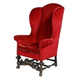 Lot 104 - A Queen Anne and later japanned beechwood wing armchair, upholstered with burgundy plush fabric,