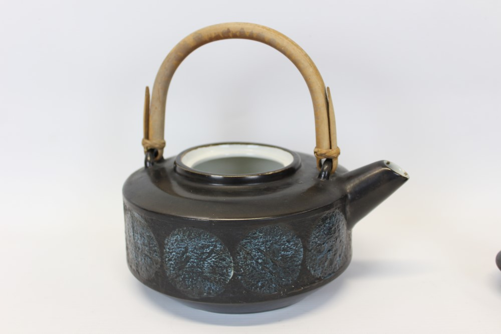 Lot 2022 - Rare Troika pottery teapot with original wicker / cane handle and drum-shaped body