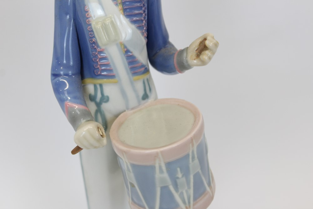 Lot 2045 - Two Lladro porcelain band figures - boy with horn and boy with drum