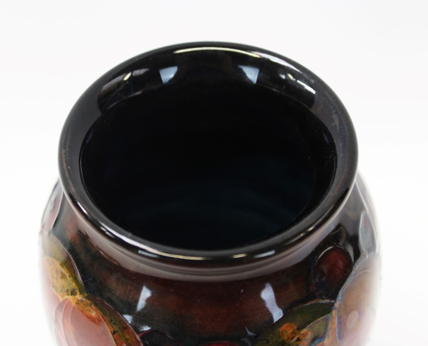 Lot 2001 - 1930s Moorcroft pottery flambé glazed vase decorated in the Leaf and Berry pattern,