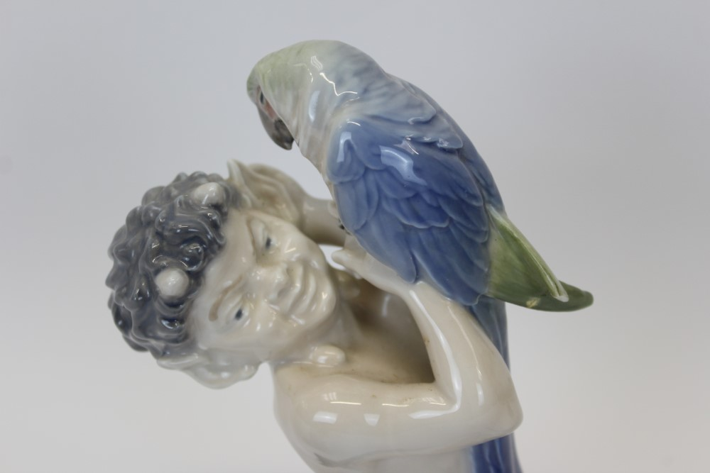 Lot 2034 - Royal Copenhagen porcelain figure of a fawn with parrot, by Christian Thomsen, numbered 752,