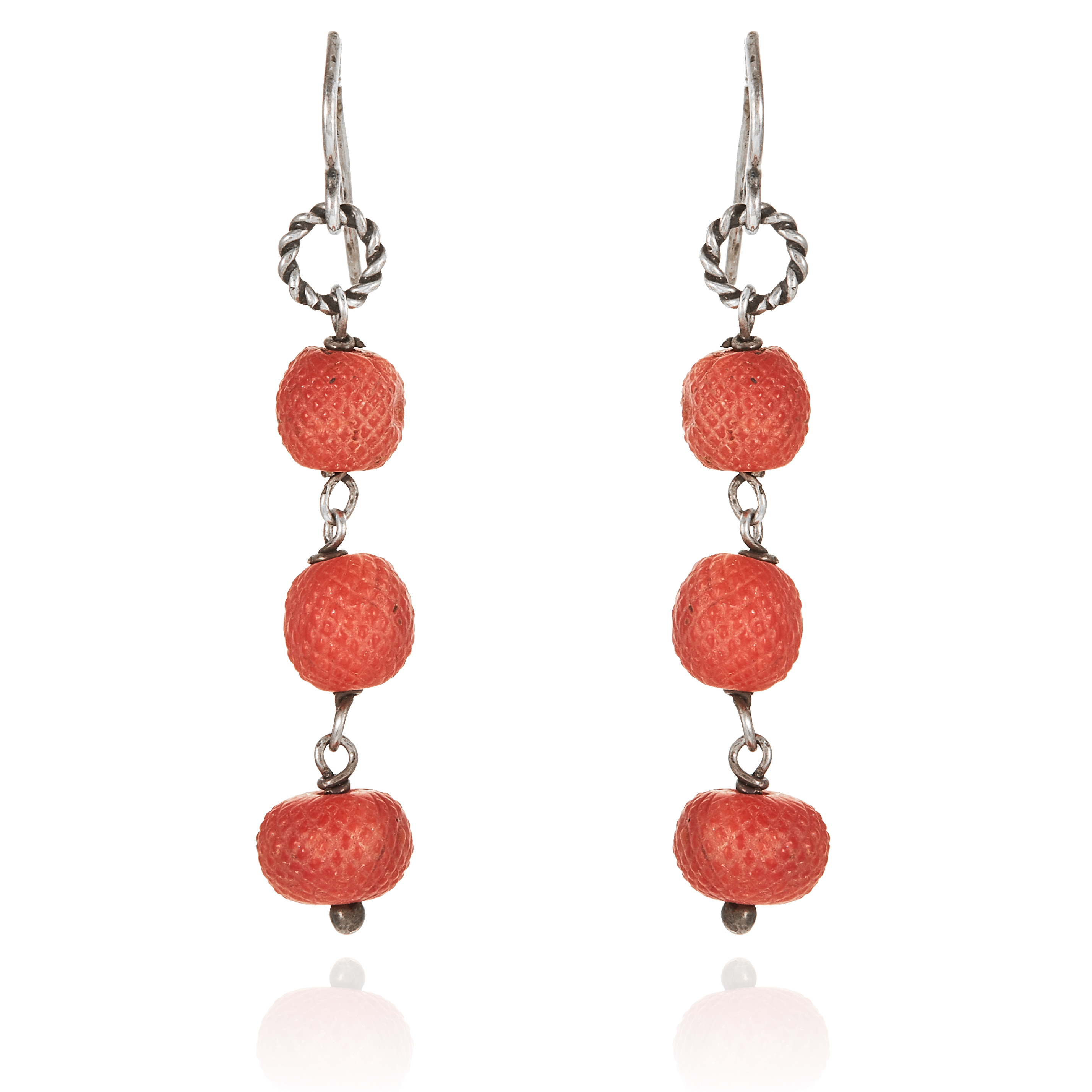 A PAIR OF ANTIQUE CARVED CORAL BEAD EARRINGS in sterling silver, each jewelled with three carved