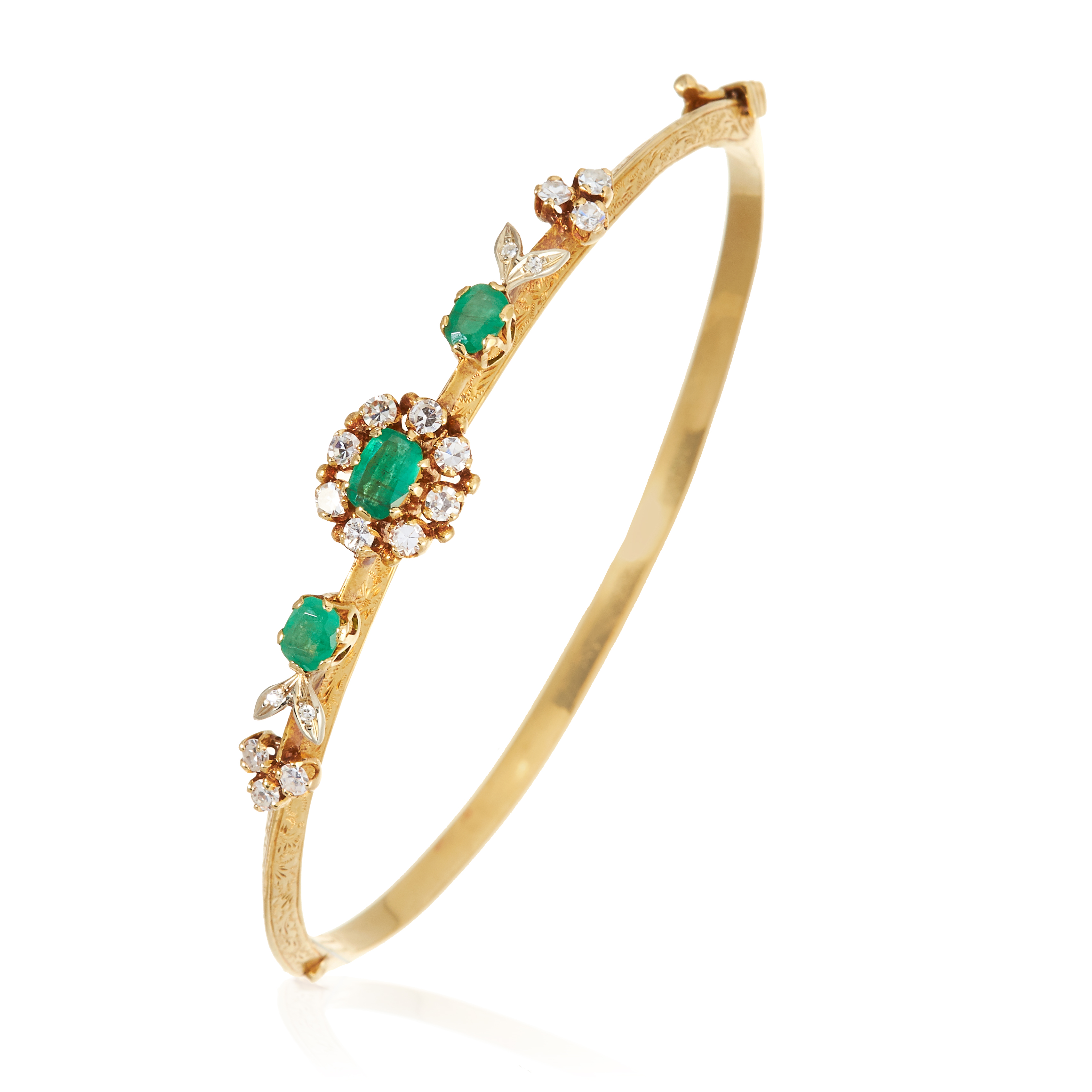 AN ANTIQUE EMERALD AND DIAMOND BANGLE in high carat yellow gold, comprising of three central oval