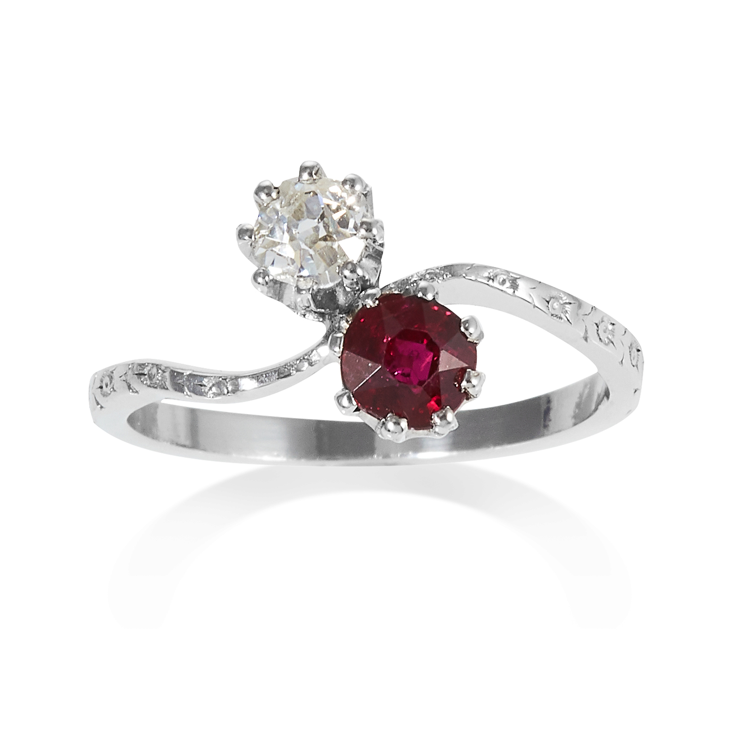 Los 3 - A RUBY AND DIAMOND TOI ET MOI RING in platinum, set with a round cut ruby of approximately 0.60