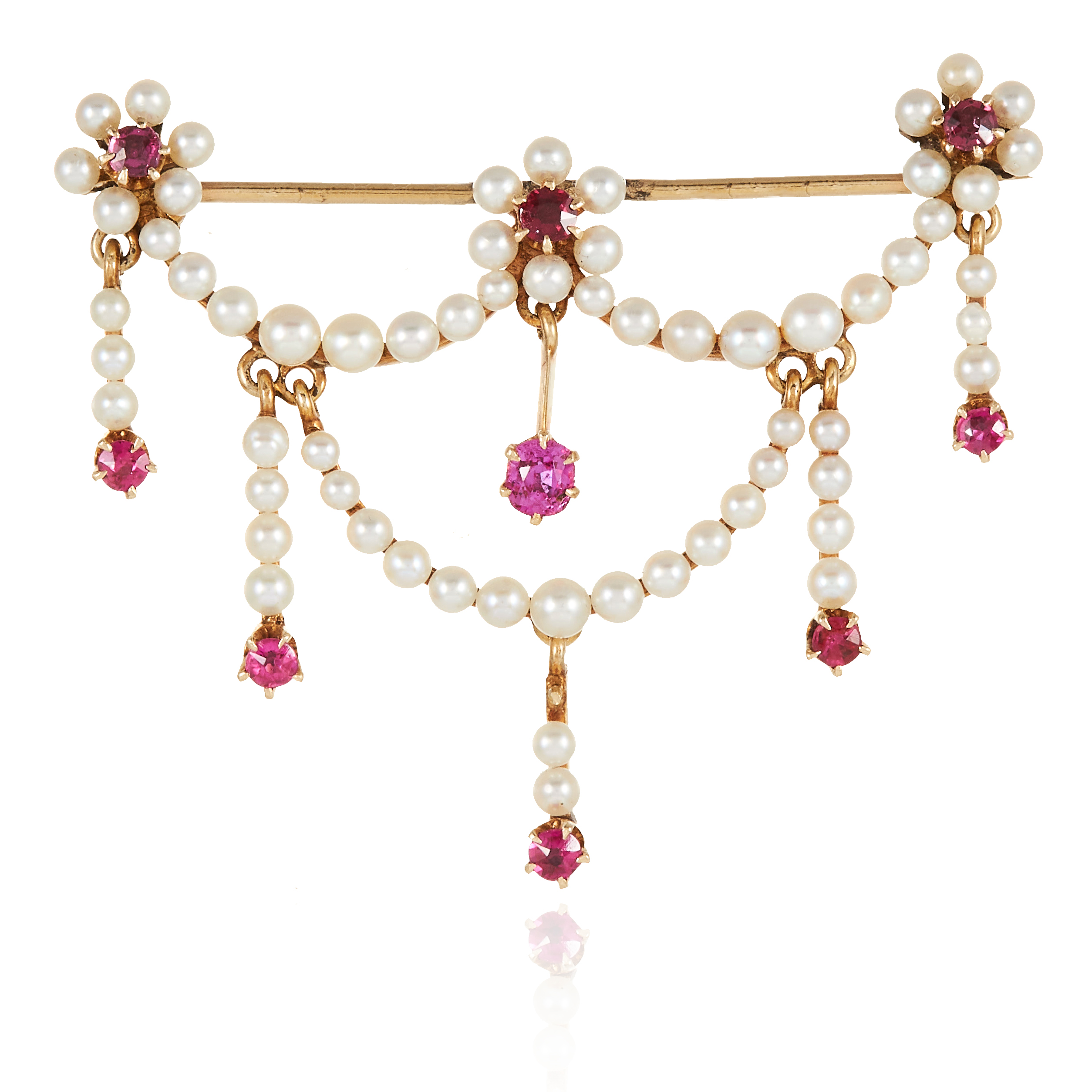 AN ANTIQUE PEARL AND RUBY BROOCH in yellow gold, comprising of floral and ribbon motif, jewelled
