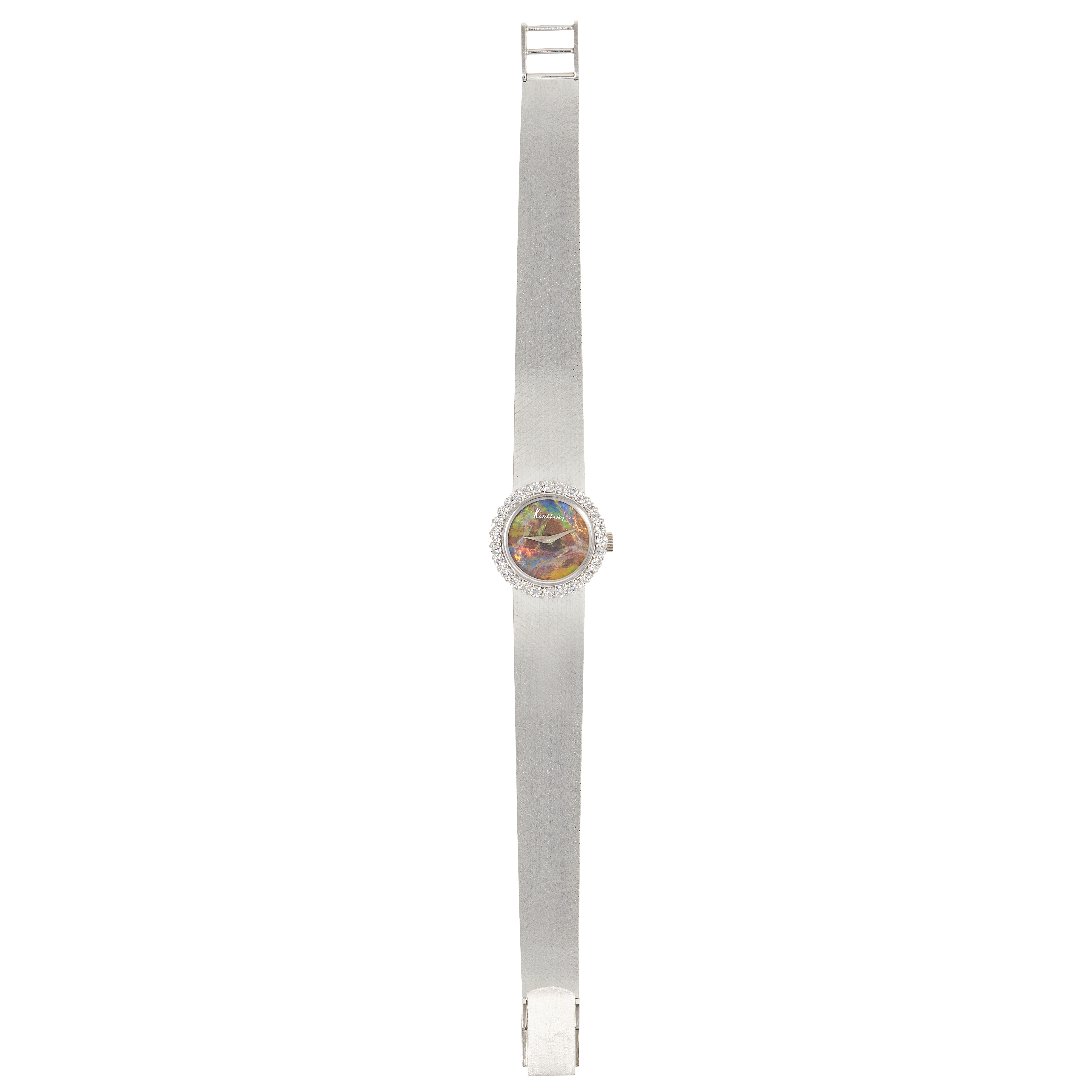 Los 76 - A VINTAGE BLACK OPAL AND DIAMOND COCKTAIL WATCH, KUTCHINSKY, CIRCA 1971 in 18ct white gold, with