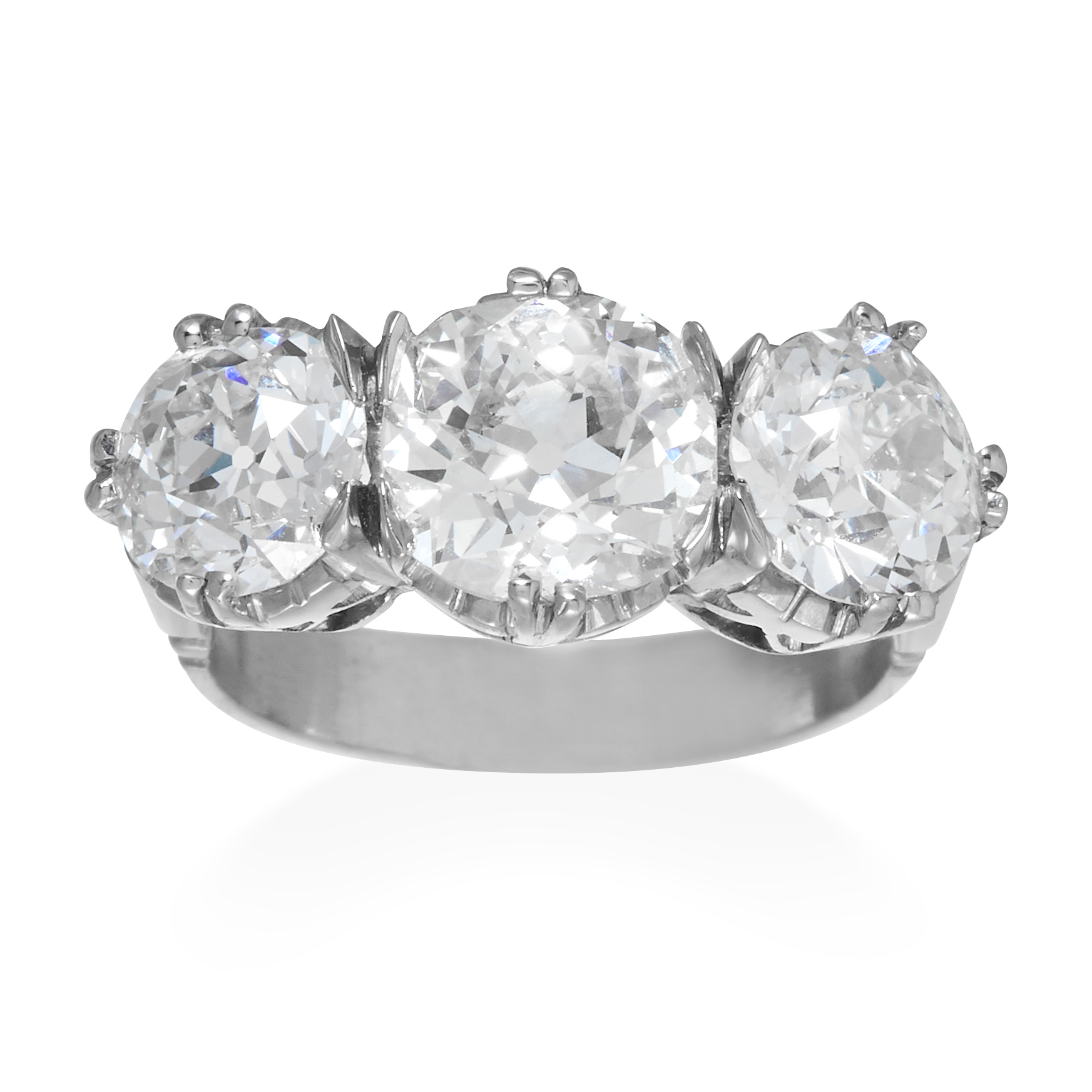 AN ANTIQUE 5.50 CARAT DIAMOND THREE STONE RING in platinum or white gold, set with three graduated