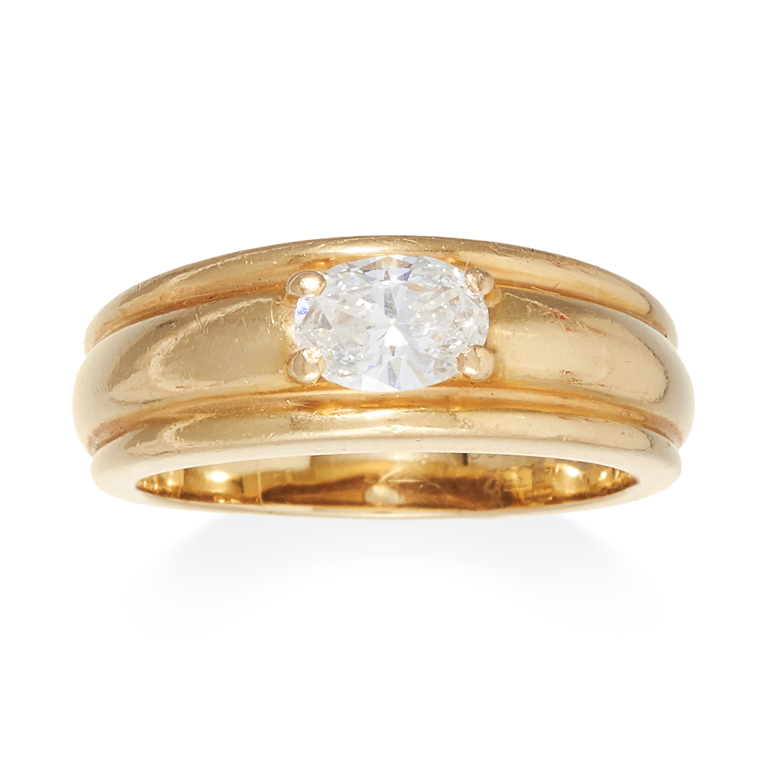 A DIAMOND RING, BOUCHERON in 18ct yellow gold, jewelled with an oval cut diamond of approximately