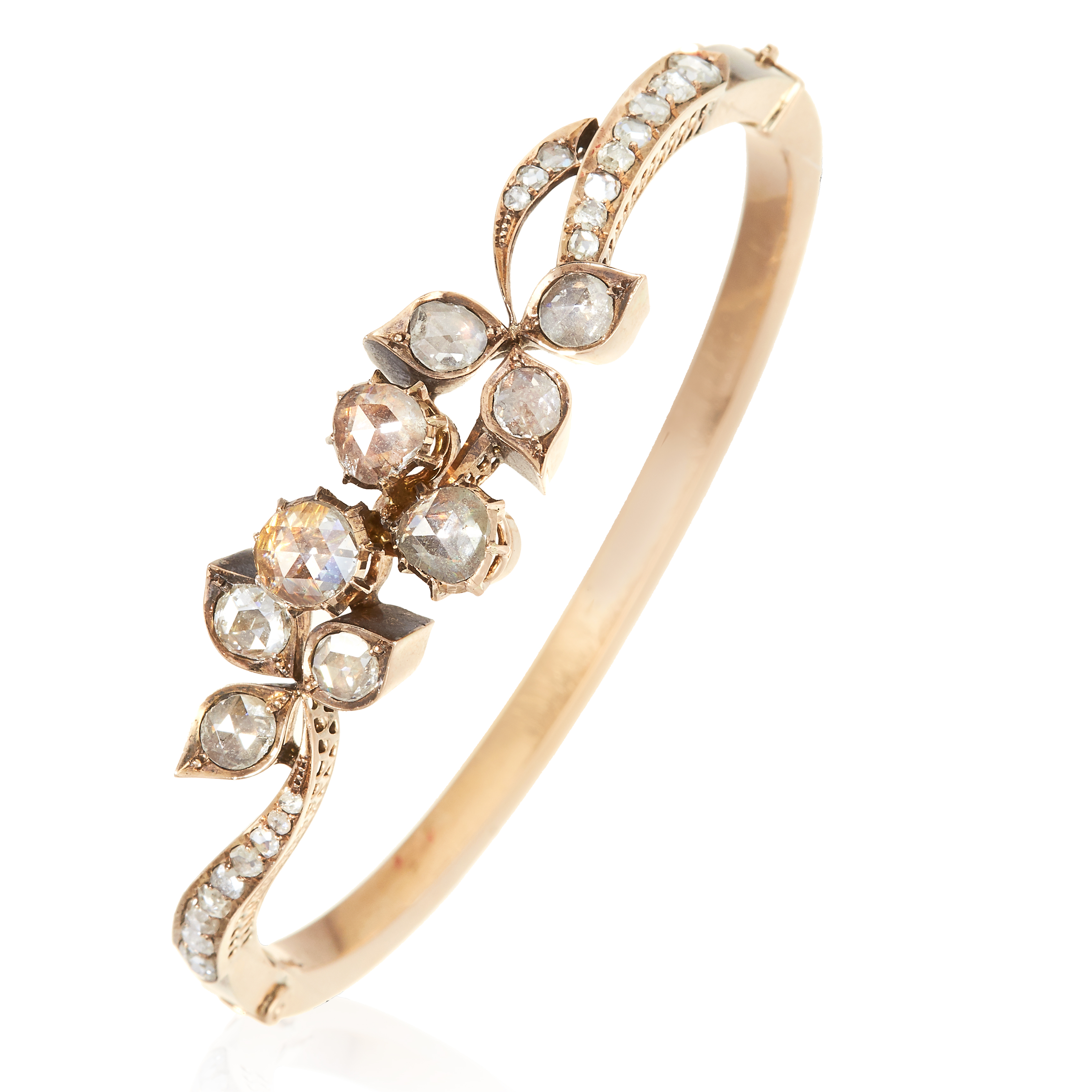 Los 16 - AN ANTIQUE DIAMOND BANGLE, 19TH CENTURY in high carat yellow gold, the foliate motif jewelled with
