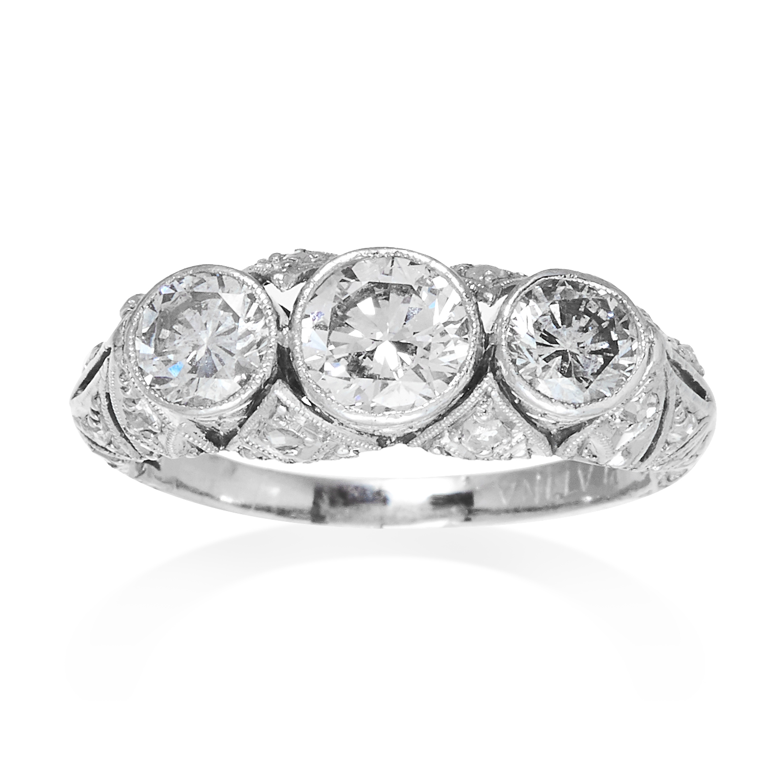 AN ART DECO DIAMOND DRESS RING in platinum, the trio of graduated round cut diamonds totalling 1.