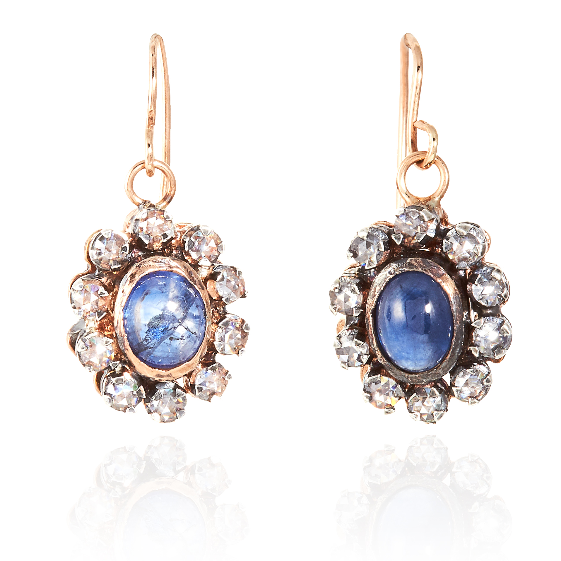 A PAIR OF ANTIQUE SAPPHIRE AND DIAMOND EARRINGS in yellow gold and silver, each with a cabochon