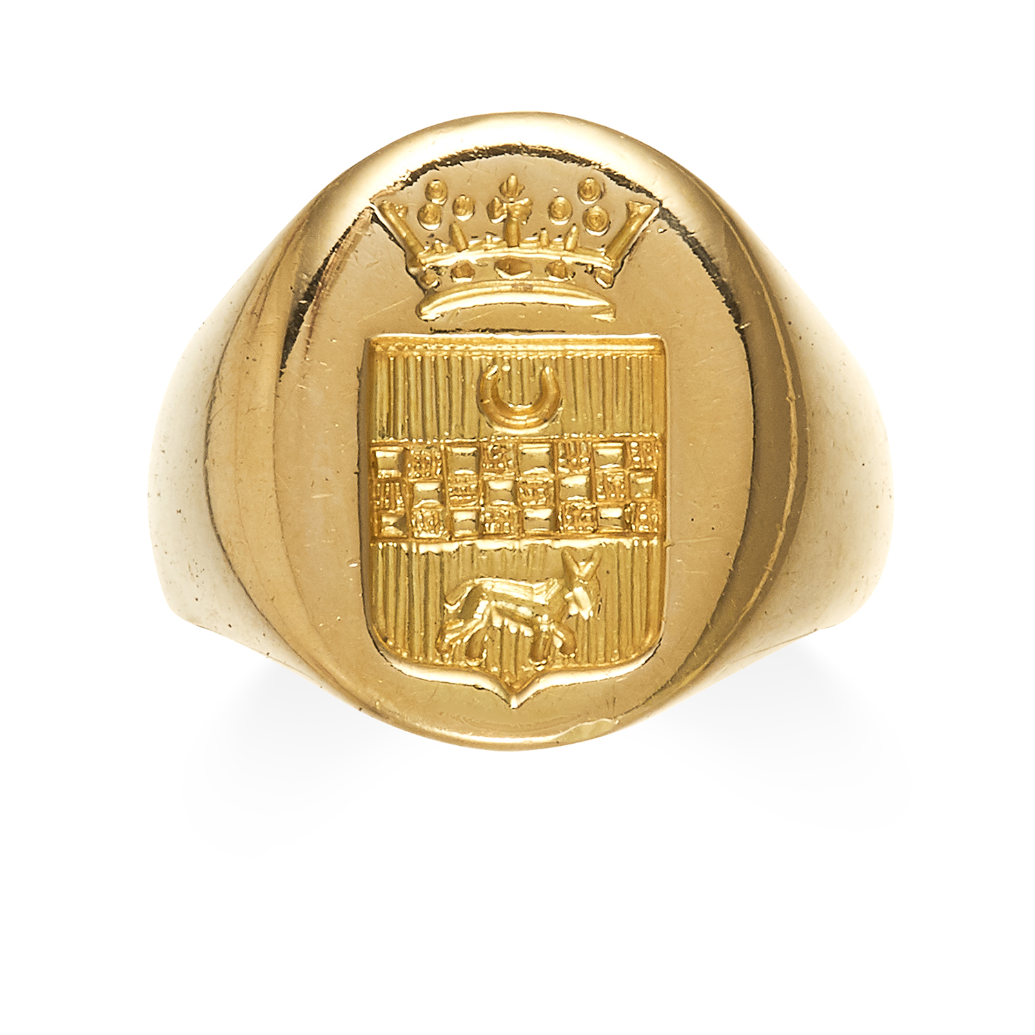 AN INTAGLIO SEAL SIGNET RING in high carat yellow gold, the oval face with a reverse engraved coat