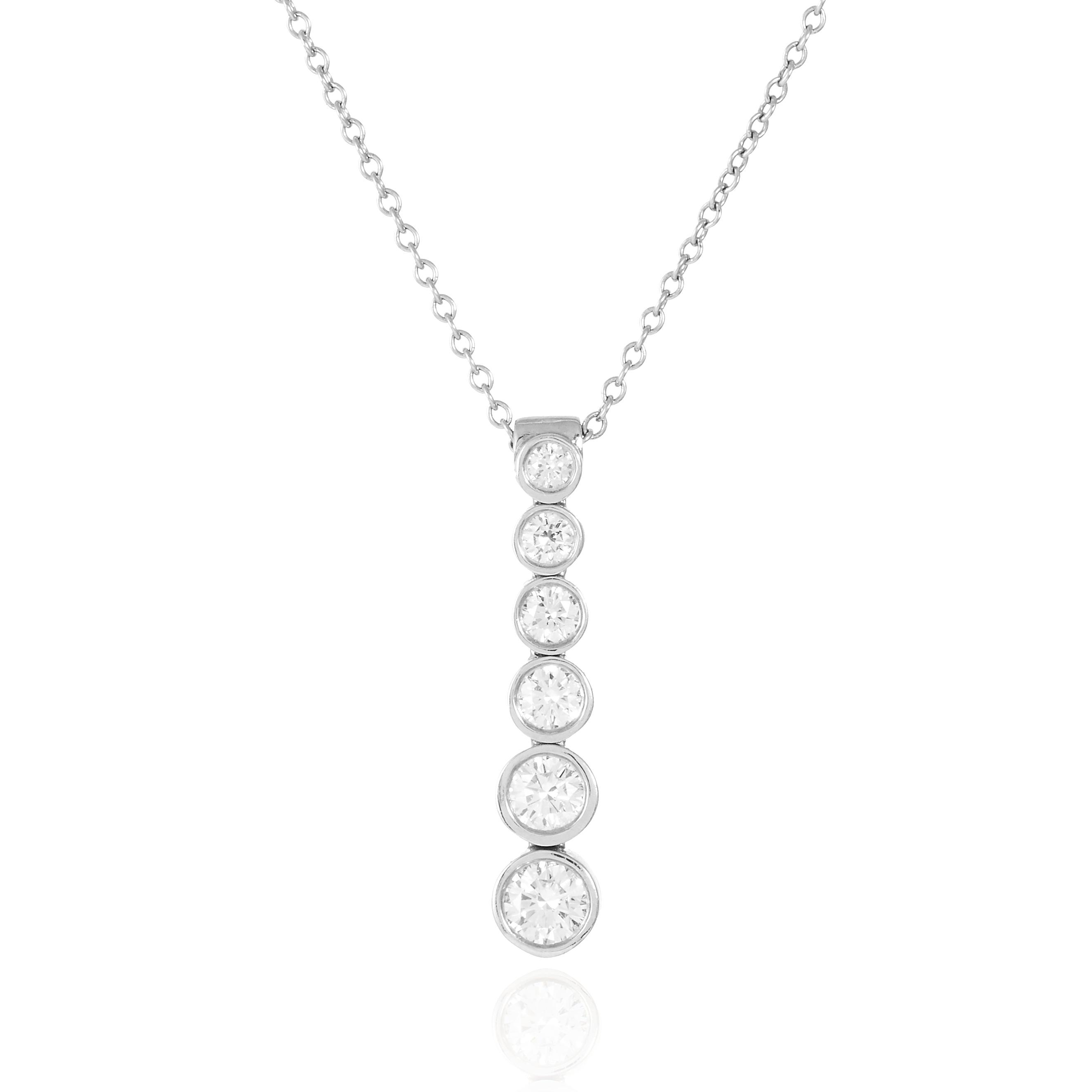 A DIAMOND PENDANT, TIFFANY AND CO, CIRCA 2003 in platinum, suspending six round cut diamonds