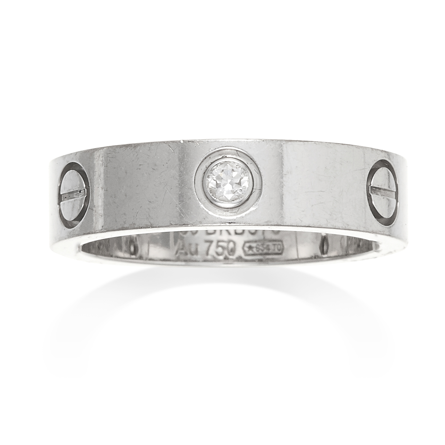 A DIAMOND LOVE RING, CARTIER in 18ct white gold, punctuated with screw head motifs, three jewelled