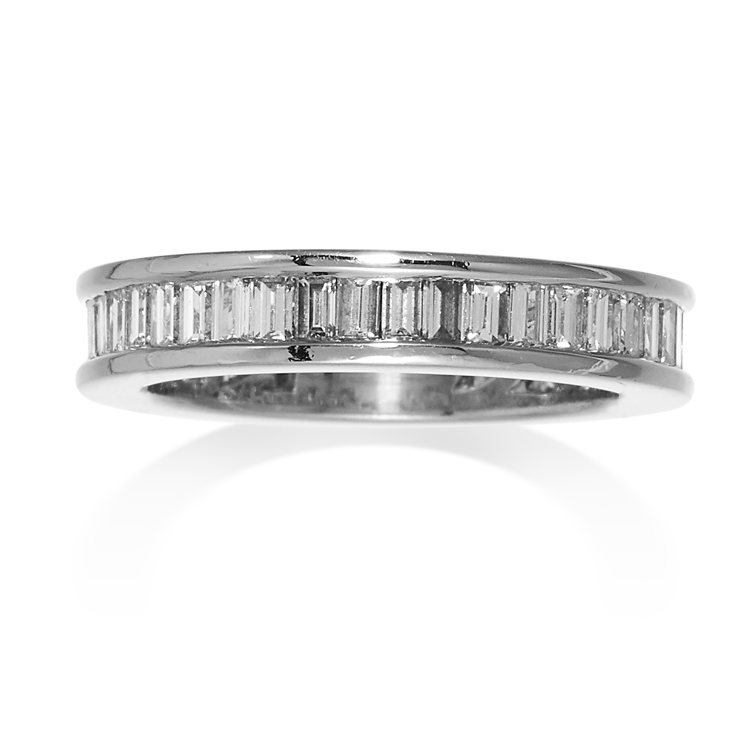 A DIAMOND ETERNITY RING in gold or platinum, jewelled with emerald cut diamonds, unmarked, size