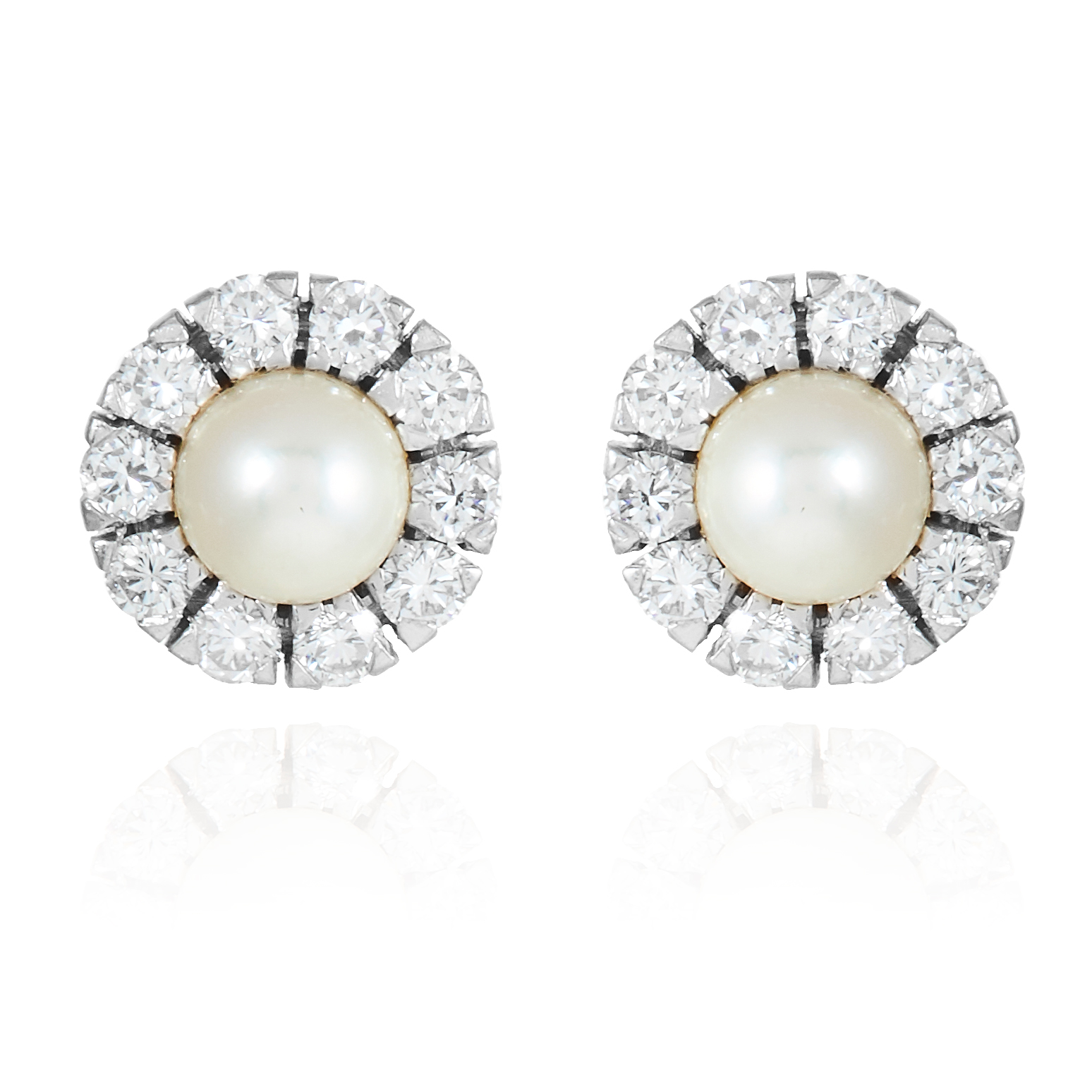 A PAIR OF DIAMOND AND PEARL STUD EARRINGS in 18 carat white gold, jewelled with round cut diamonds
