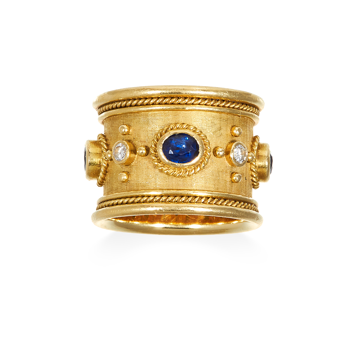 A SAPPHIRE AND DIAMOND RING, ELIZABETH GAGE, CIRCA 1993 in 18ct yellow gold, the wide textured