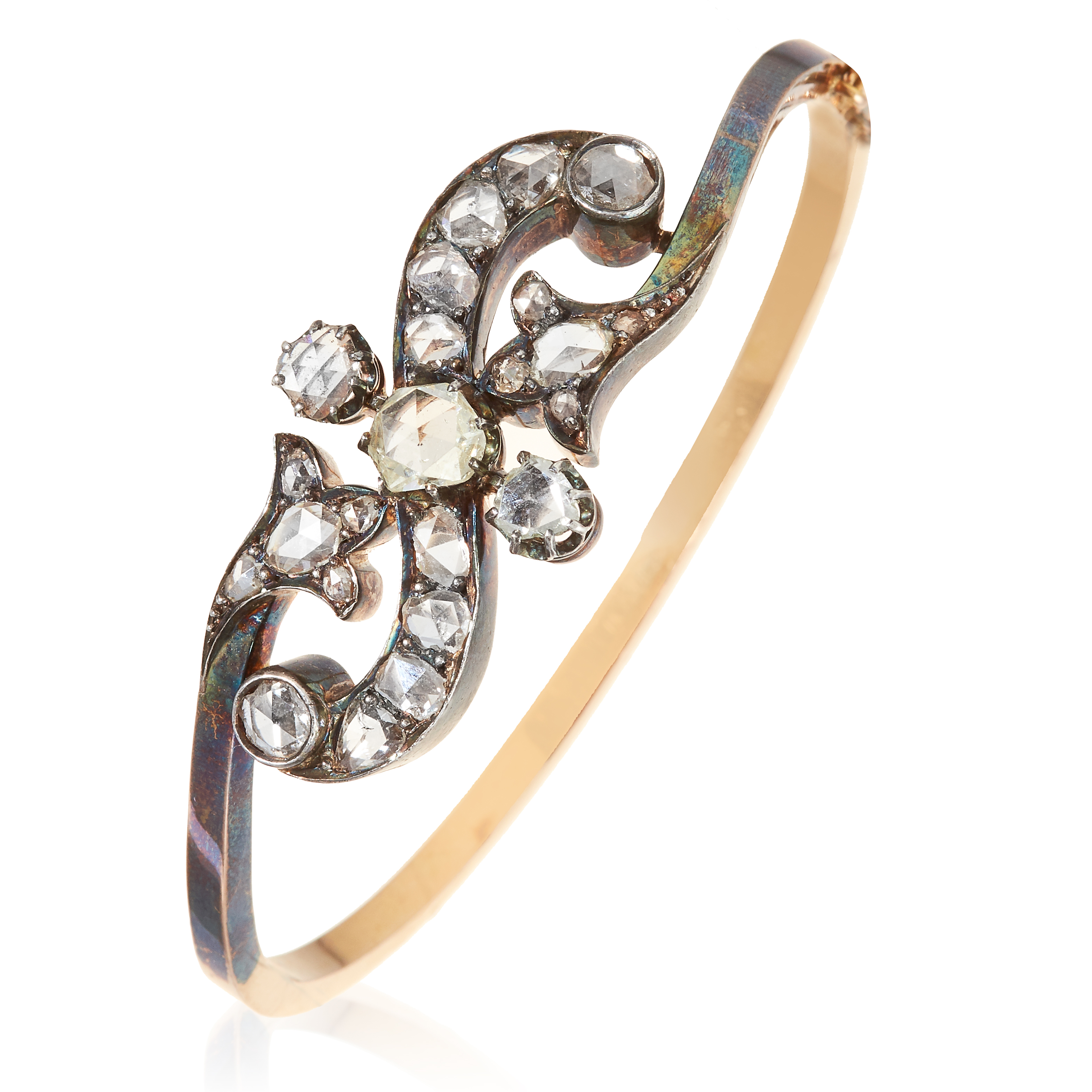 AN ANTIQUE DIAMOND BANGLE, 19TH CENTURY in high carat yellow gold, the scrolling motif jewelled with