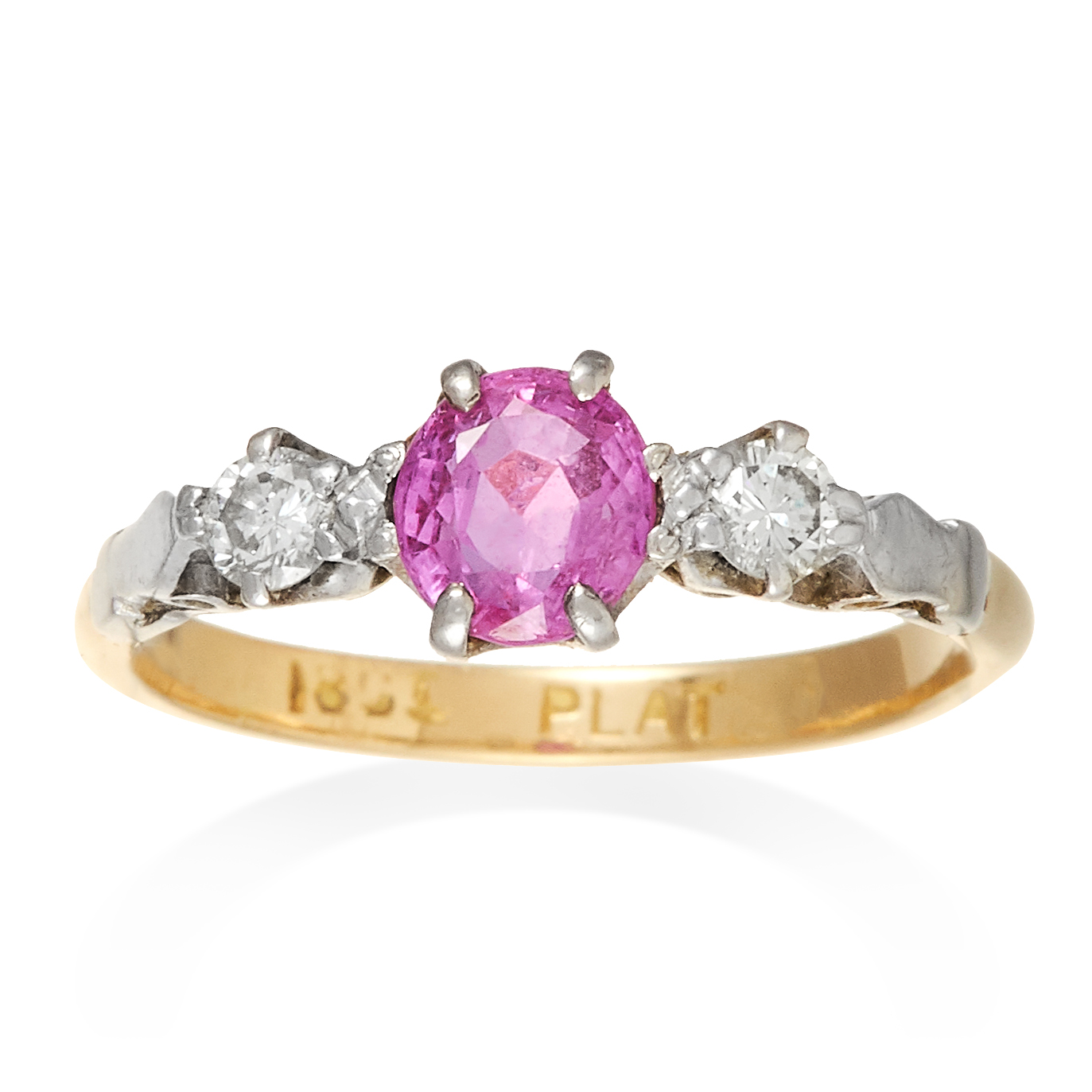 AN ANTIQUE PINK SAPPHIRE AND DIAMOND THREE STONE RING in 18ct yellow gold and platinum, the oval cut