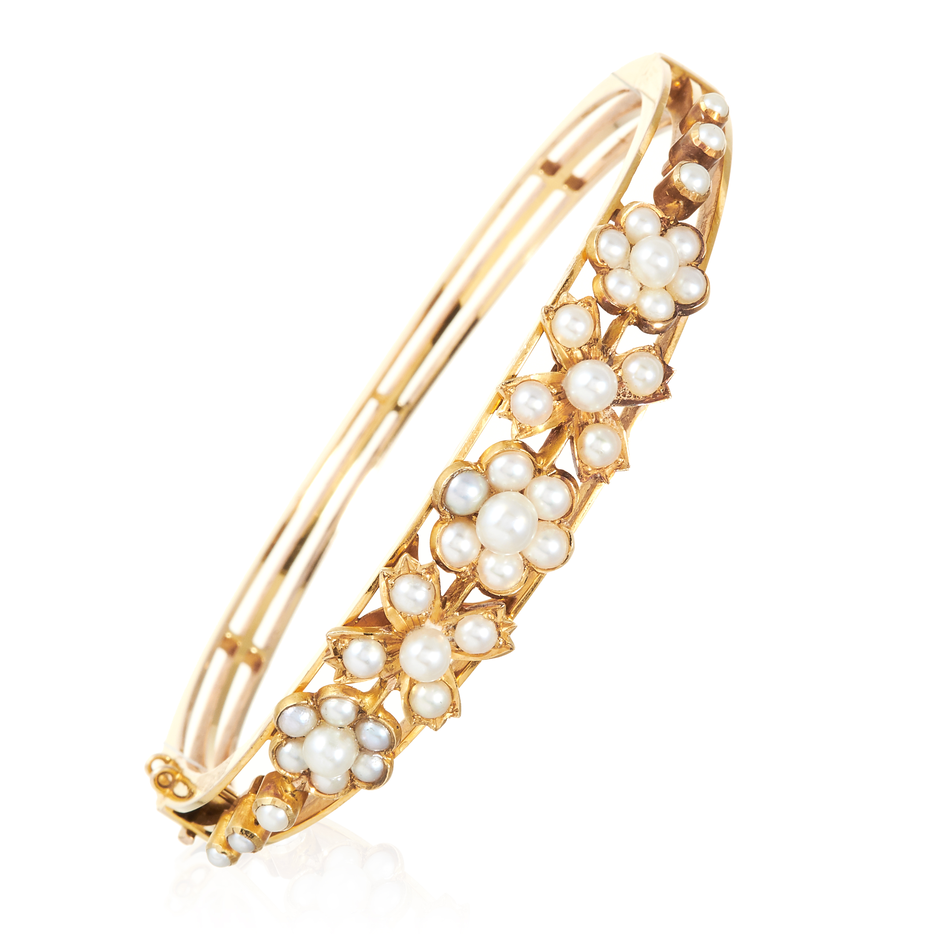AN ANTIQUE PEARL BANGLE, 19TH CENTURY in high carat yellow gold, the floral and leaf motifs jewelled