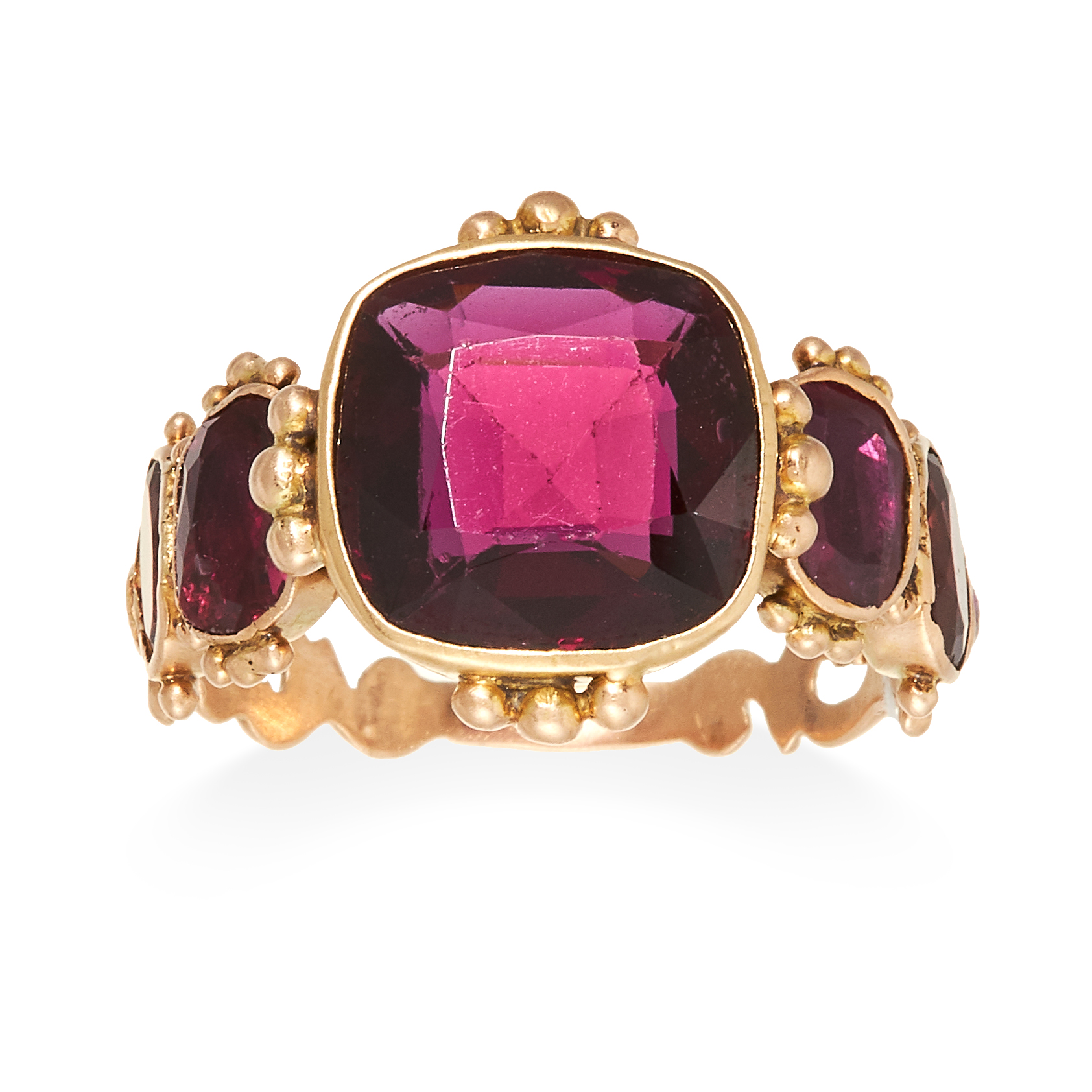 AN ANTIQUE GARNET RING, 19TH CENTURY in high carat yellow gold, set with a central cushion cut
