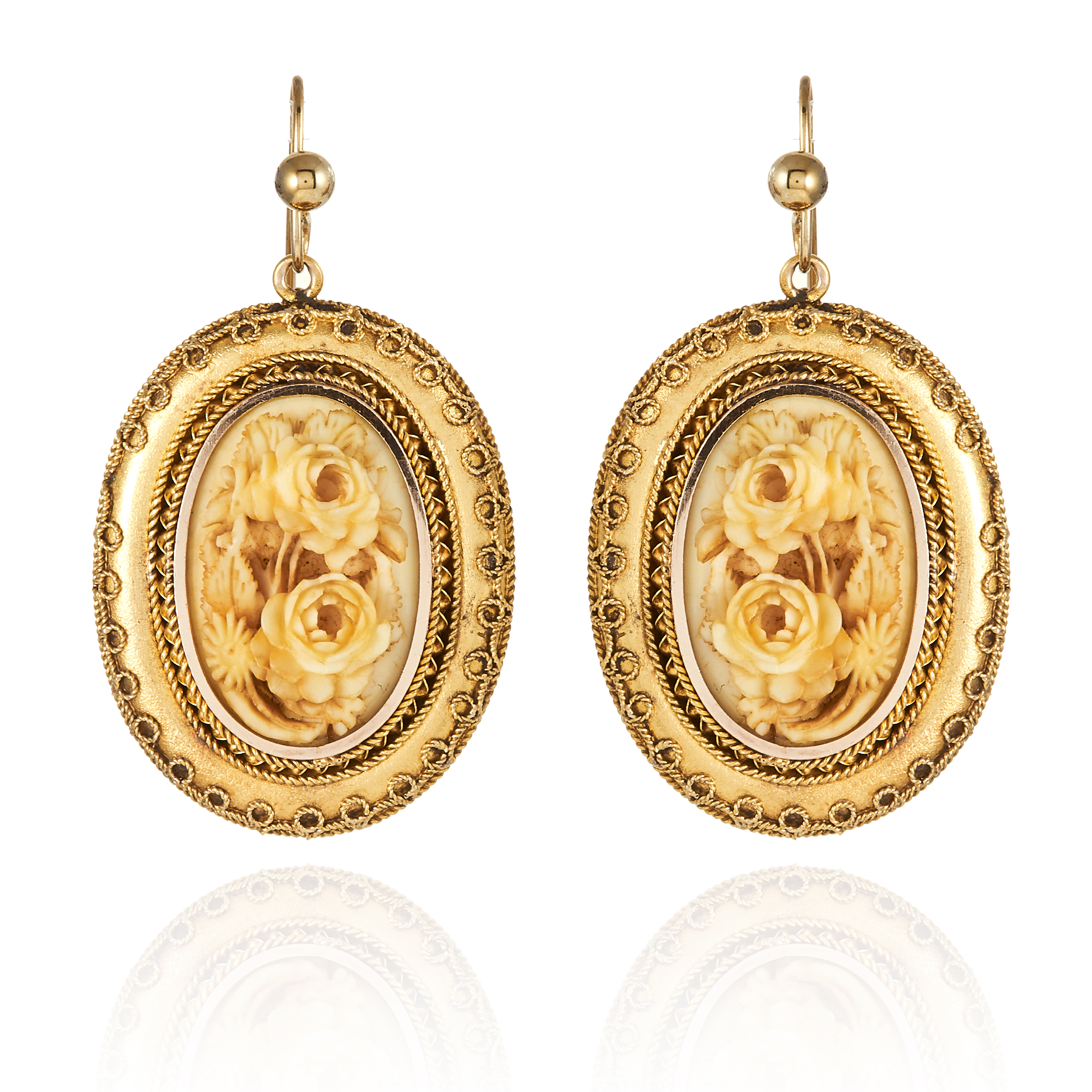 Los 44 - A PAIR OF ANTIQUE CARVED IVORY EARRINGS, in high carat yellow gold, comprising of an ornate gold