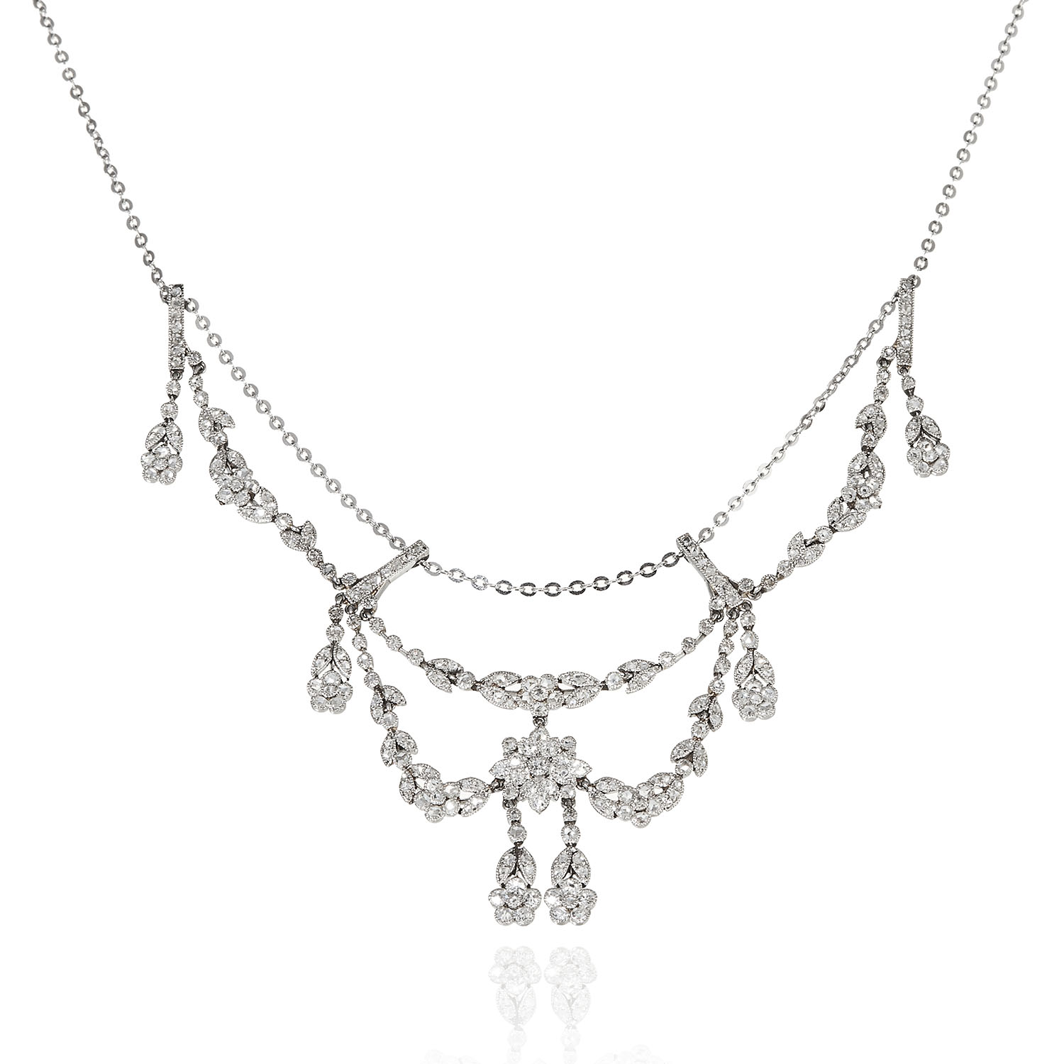 AN ANTIQUE DIAMOND NECKLACE in white gold or platinum, designed in floral and foliate motif,