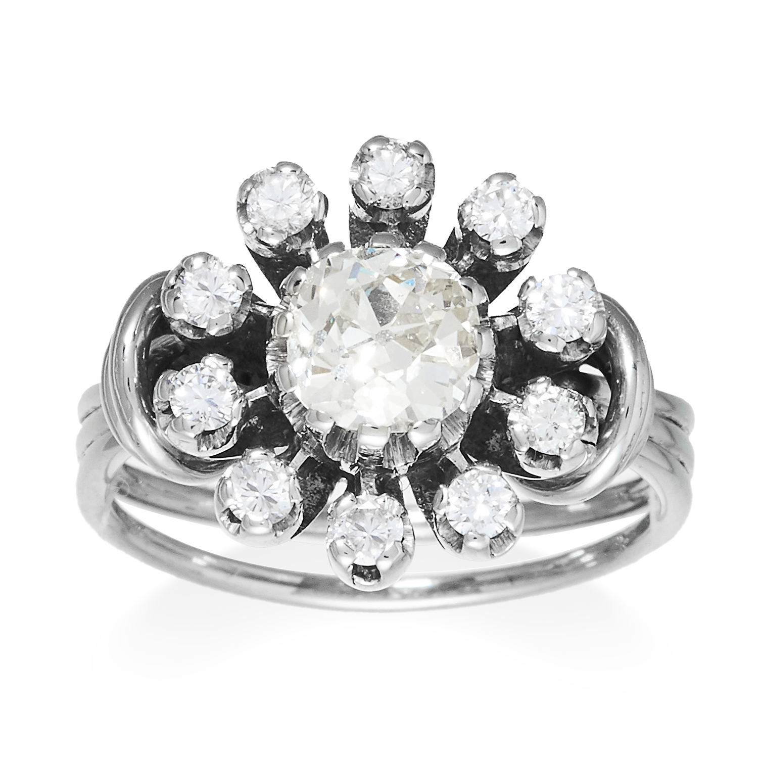 A DIAMOND CLUSTER DRESS RING in platinum or white gold, set with an old cut diamond of 1.20 carats