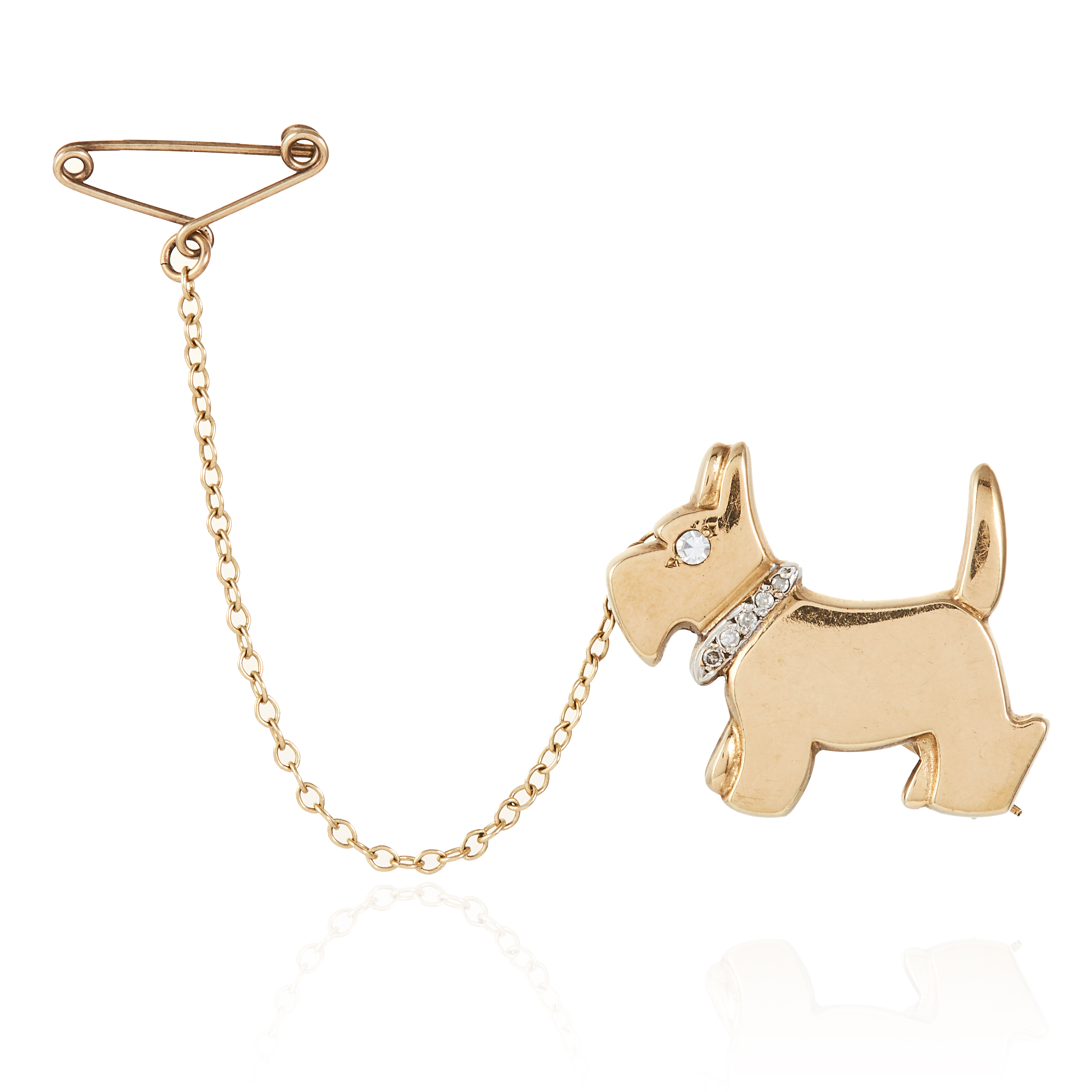 A DIAMOND SCOTTIE DOG BROOCH in yellow gold, designed as a Scottish terrier with diamond jewelled