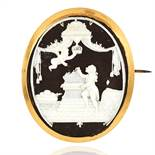 AN ANTIQUE IVORY MINIATURE BROOCH yellow gold, comprising of oval ebony in gold mount and a