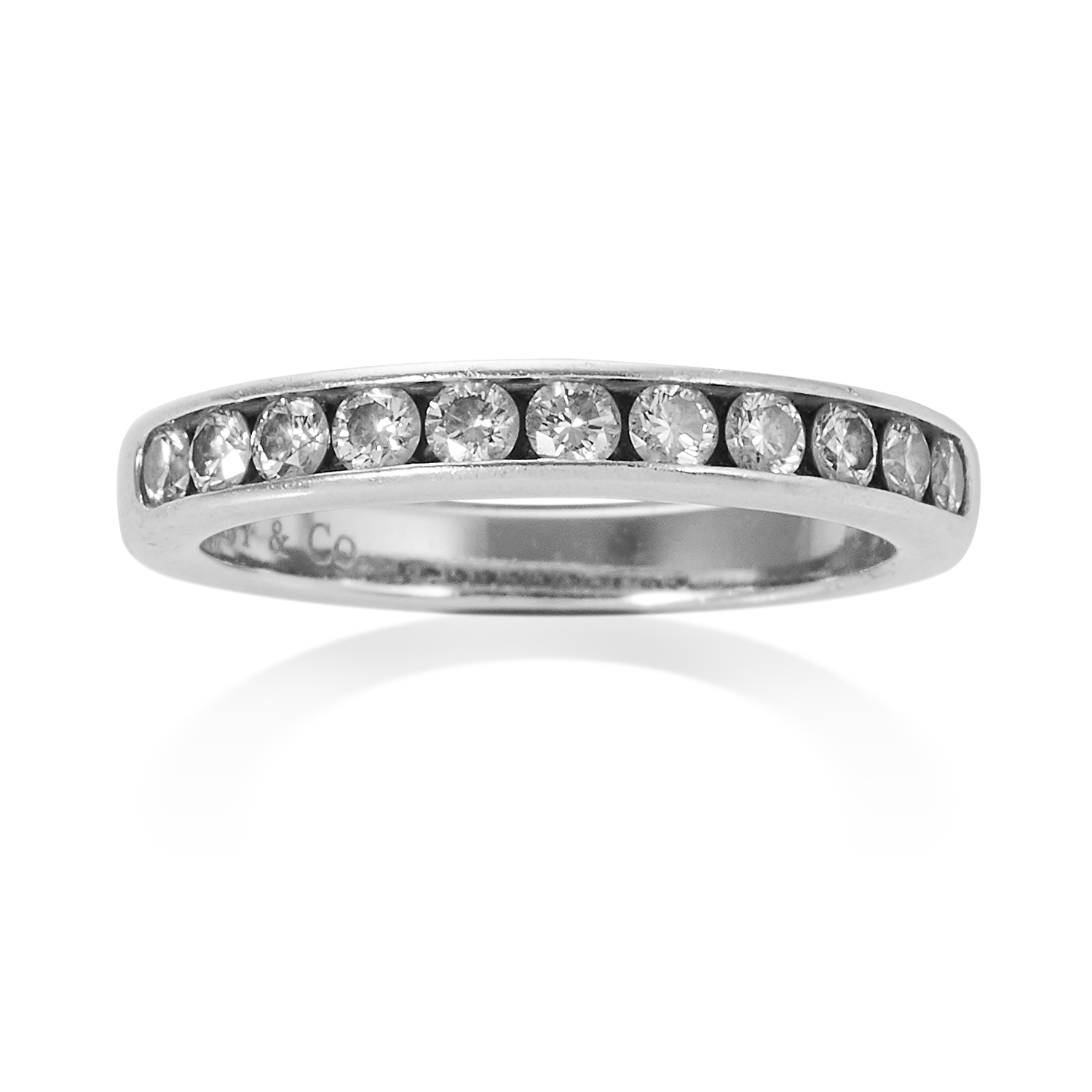 Los 7 - A 0.44 CARAT DIAMOND HALF ETERNITY RING, TIFFANY & CO in platinum, set with eleven round brilliant