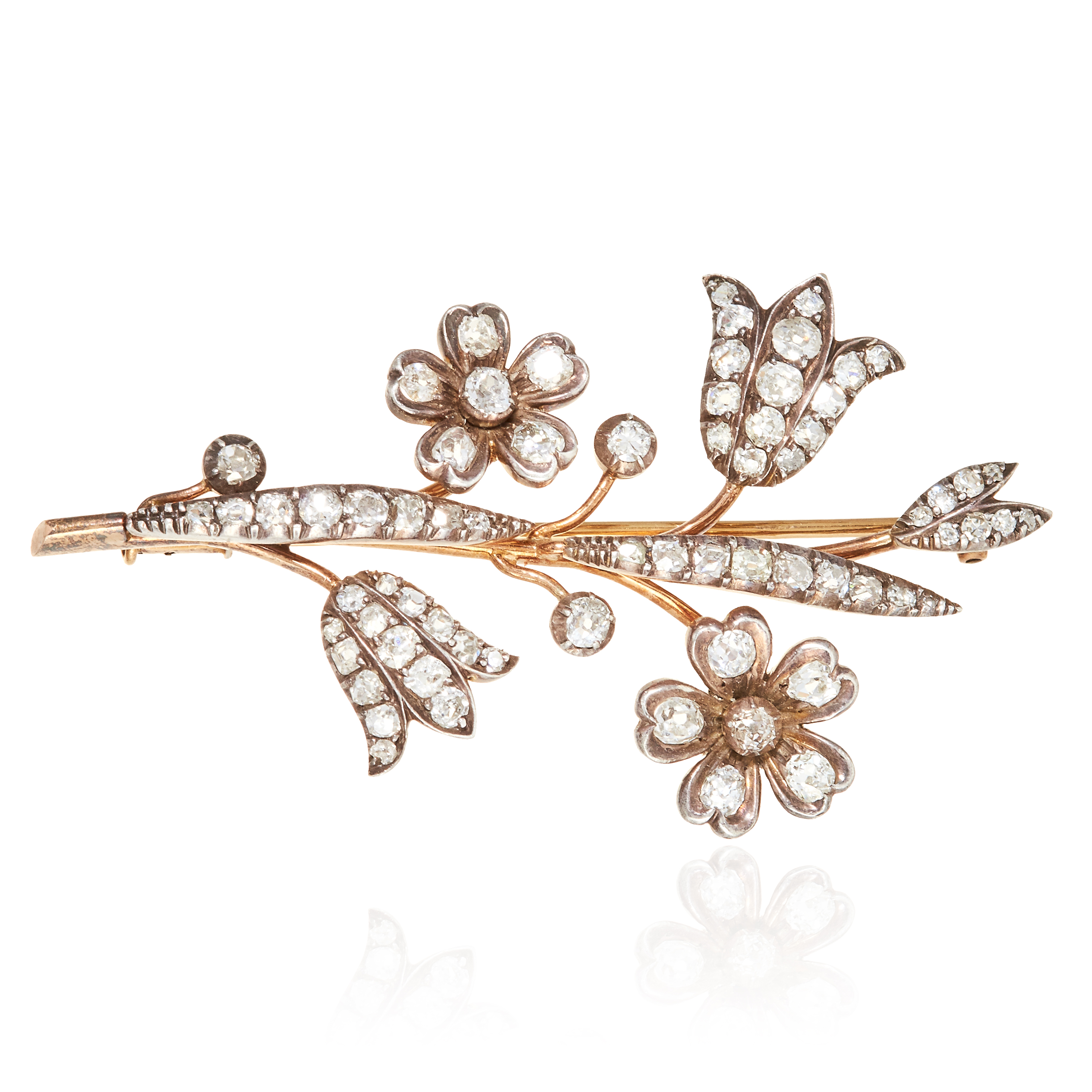 Los 36 - A DIAMOND FLOWER SPRAY BROOCH in gold or silver, designed as floral spray jewelled with old cut