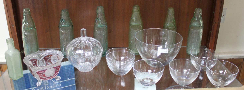 Seven various green glass bottles including Hartridge & Sons, together with a dessert serving set of