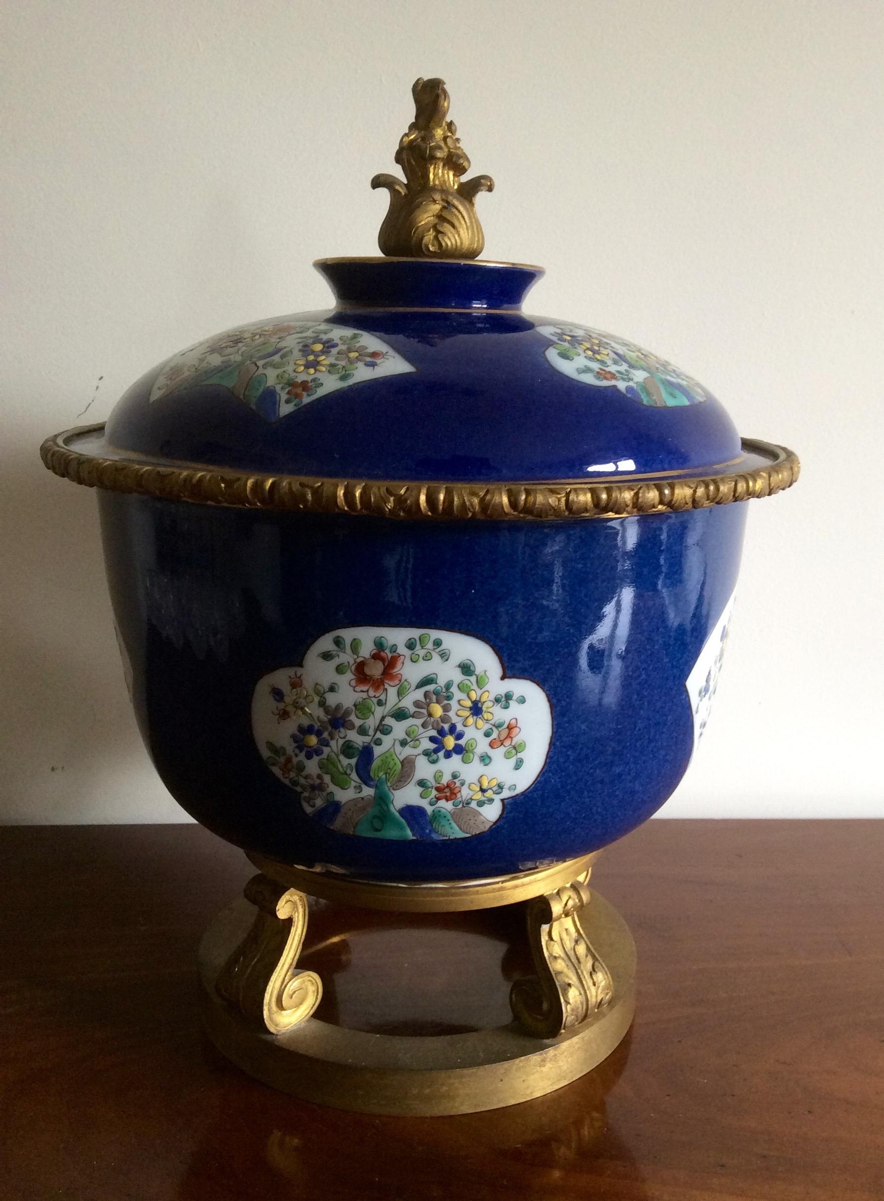 Lot 22 - Powder blue porcelain bowl with enamel panels and gilt mounts