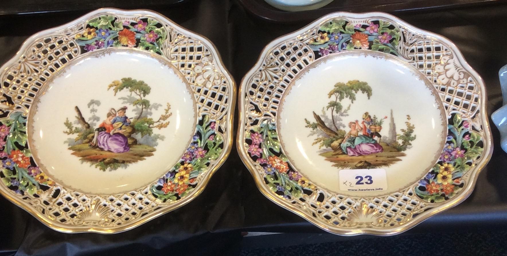 Lot 23 - Pair of Meissen porcelain plates slight a/f to glaze.20cms diameter.