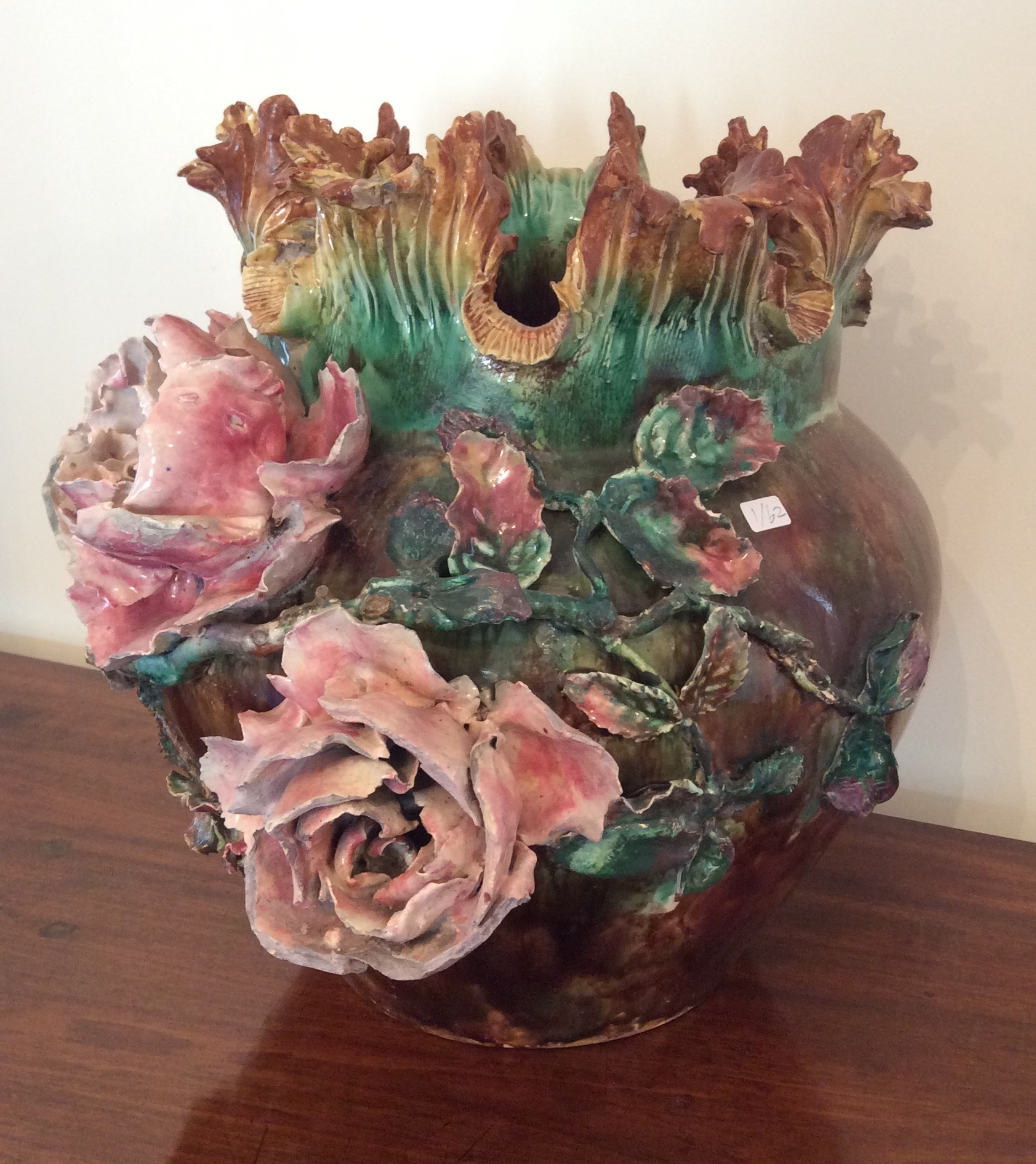 Lot 59 - Continental majolica vase with applied roses