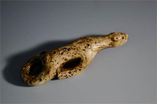 An Inuit Bone Pendant Carved As A Stylized Polar Bear 9 5cm Long 19th Century