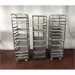 3 stainless steel racks with trays