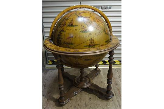 - A Drinks Cabinet In The Form Of A Globe On Turned Frame