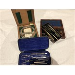 Two sets of drawing instruments and a protractor in orig cases