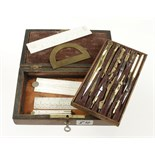 A 12 piece brass drawing set with four ivory rules in lockable rosewood box G