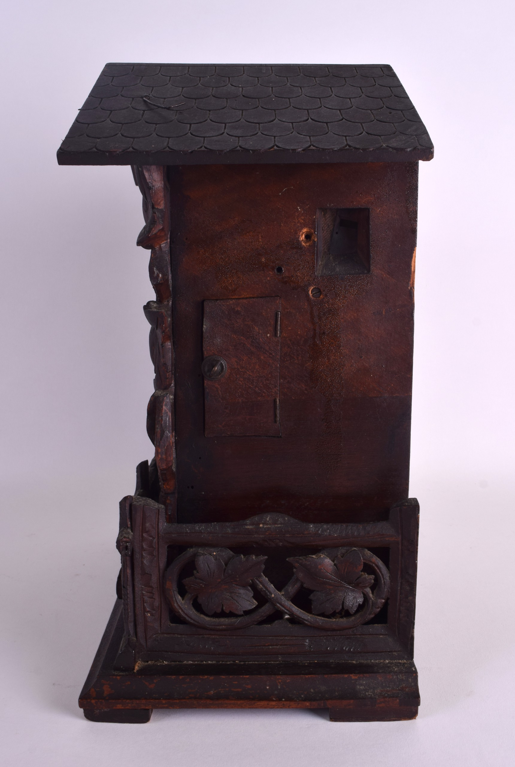 Lot 1000 - AN EARLY 20TH CENTURY GERMAN BAVARIAN BLACK FOREST CUCKOO CLOCK overlaid with vines and leaves. 39