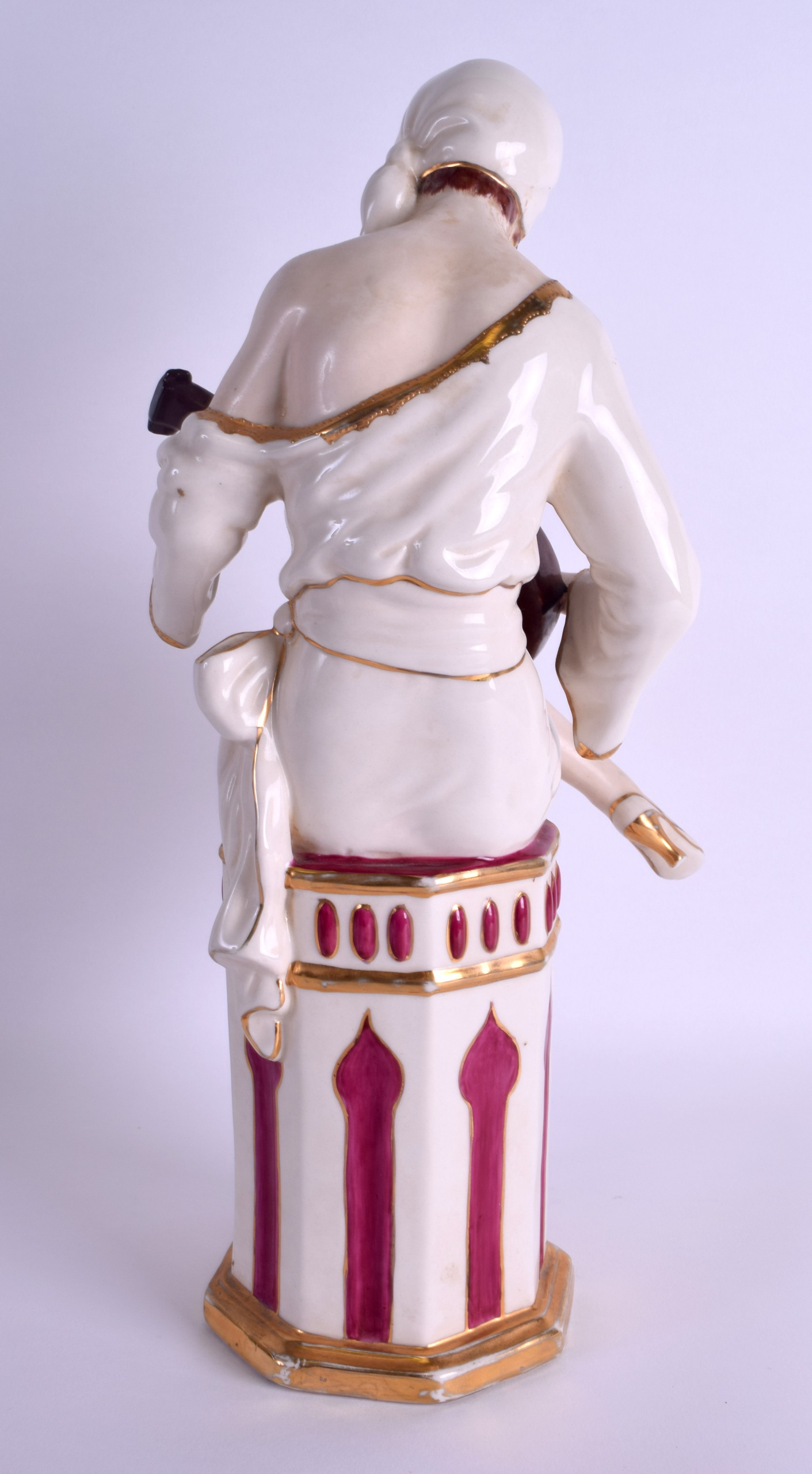 Lot 83 - A LARGE ART DECO AUSTRIAN ROYAL DUX FIGURE OF A SEMI CLAD MUSICIAN modelled playing an instrument