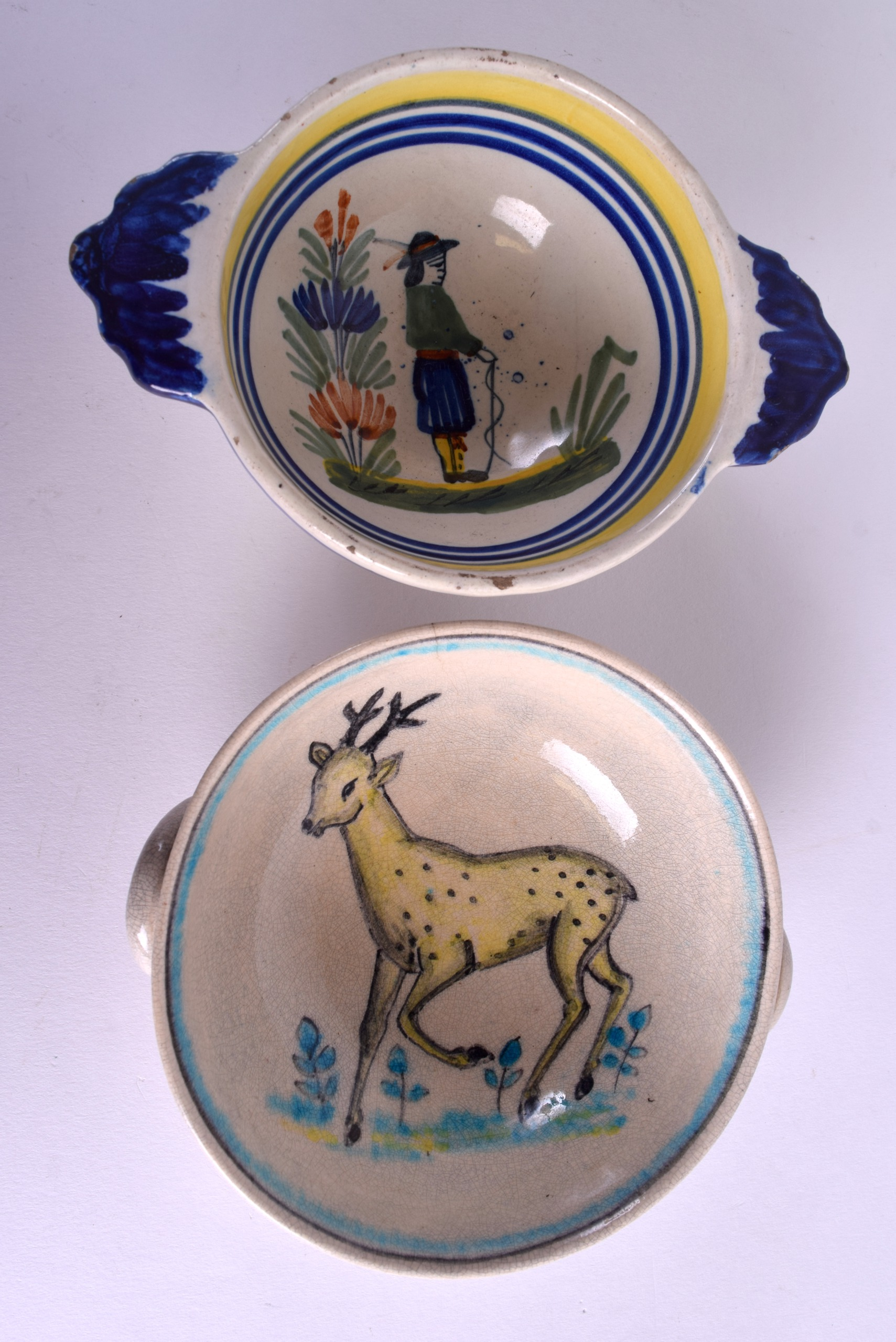Lot 97 - TWO EARLY 20TH CENTURY FRENCH FAIENCE QUAICHES one bearing Quimper signature. 14 cm & 12 cm wide. (