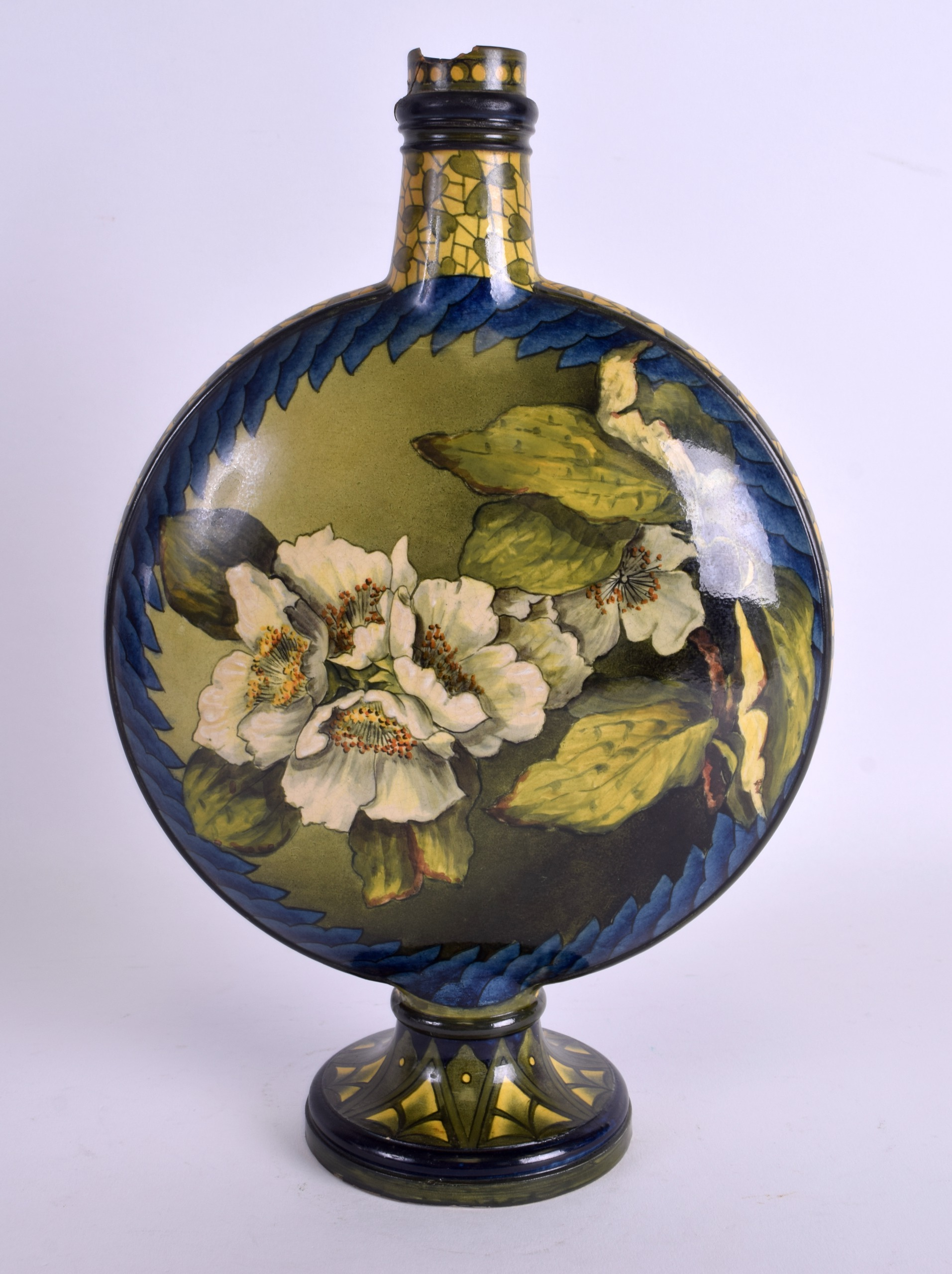Lot 79 - AN ARTS AND CRAFTS ROYAL DOULTON MOON FLASK painted with floral sprays. 28 cm x 18 cm.
